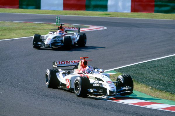 2004 Japanese Grand Prix.Suzuka , Japan 8th - 10th October 2004Jenson Button, BAR Honda 006 leads team mate Takuma Sato, BAR Honda 006. Action. World Copyright:Charles Coates/LAT Photographic ref: 35mm Image: A13