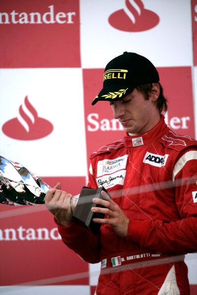 Round 4.Silverstone, England. 11th July 2010. Sunday Race. Mirko Bortolotti, (ITA, Addax Team) celebrates on the podium. Portrait.  World Copyright: Drew Gibson/GP3 Media Service.  Digital Image _Y8P1359