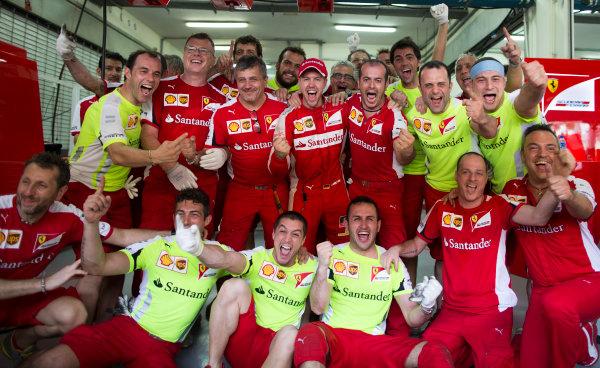 Sepang International Circuit, Sepang, Kuala Lumpur, Malaysia. Sunday 29 March 2015. Sebastian Vettel, Ferrari, celebrates his win with the Ferrari team. World Copyright: Lorenzo Bellanca/LAT Photographic. ref: Digital Image _55K5043