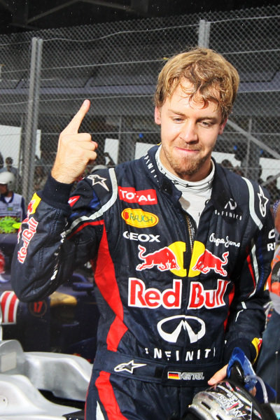 World Champion Sebastian Vettel (GER) Red Bull Racing celebrates in parc ferme. Formula One World Championship, Rd20 Brazilian Grand Prix, Race, Sao Paulo, Brazil, 25 November 2012.