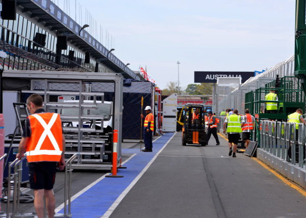 Freight is unloaded in pit lane.