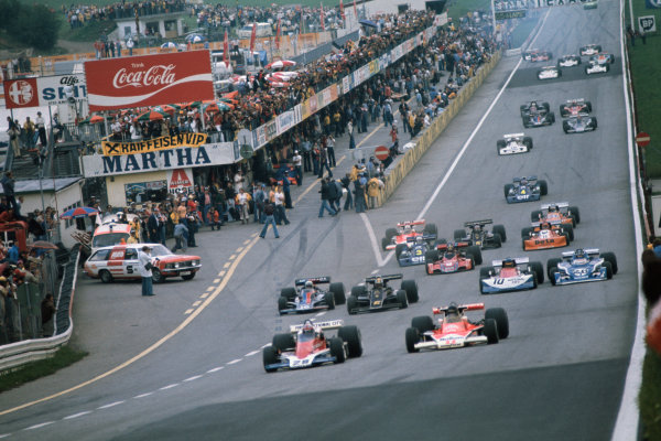 Osterreichring, Zeltweg, Austria. 13th - 15th August 1976.  John Watson (Penske PC4-Ford), 1st position leads James Hunt (McLaren M23-Ford), 4th position, at the start of the race, action. World Copyright: LAT Photographic  Ref: 76 AUT 16.