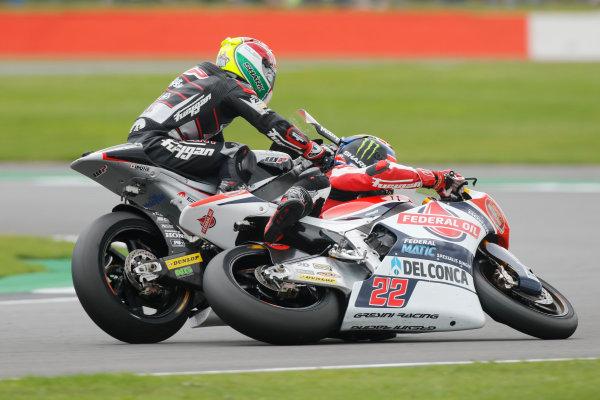 2016 Moto2 Championship.  British Grand Prix.  Silverstone, England. 2nd - 4th September 2016.  Sam Lowes, Kalex, and Johann Zarco, Kalex, crash.  Ref: _W7_8640a. World copyright: Kevin Wood/LAT Photographic