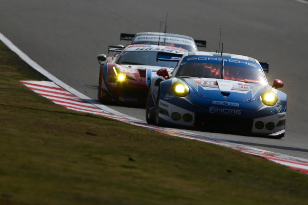 2016 FIA World Endurance Championship, Shanghai, China. 4th - 6th November 2016. Christian Reid / Wolf Henzler / Joel Camathias - KCMG Porsche 911 RSR. World Copyright: Ebrey / LAT Photographic.