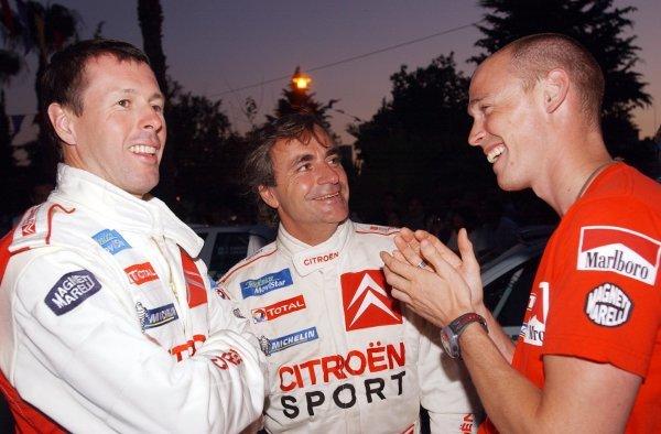 A friendly conversation before the start of the rally: Colin McRae (GBR) Citroen Xsara WRC; Carlos Sainz (ESP) Citroen Xsara WRC; Richard Burns (GBR) Peugeot 206 WRC.World Rally Championship, Rd7, Cyprus Rally, Limassol, Cyprus, 20-22 June 2003.DIGITAL IMAGE