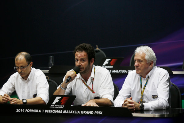 Sepang International Circuit, Sepang, Kuala Lumpur, Malaysia. Friday 28 March 2014. Fabrice Lom, Head of Powertrain, FIA, Matteo Bonciani, Media Delegate, FIA, and Charlie Whiting, Race Director, FIA, in the FIA Press Conference. World Copyright: Charles Coates/LAT Photographic. ref: Digital Image _J5R0206