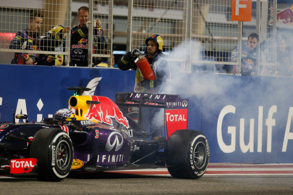 Bahrain International Circuit, Sakhir, Bahrain. Sunday 19 April 2015. The engine in the car of Daniel Ricciardo, Red Bull Racing RB11 Renault, lets go as he crosses the line. World Copyright: Glenn Dunbar/LAT Photographic. ref: Digital Image _W2Q0278