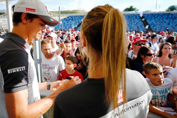 Hungaroring, Budapest, Hungary. Thursday 21 July 2016. Esteban Gutierrez, Haas F1 signs autographs for fans. World Copyright: Andrew Hone/LAT Photographic ref: Digital Image _ONZ0593