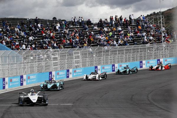Edoardo Mortara (CHE), Venturi Racing, Silver Arrow 02, leads Mitch Evans (NZL), Jaguar Racing, Jaguar I-TYPE 5, and Andre Lotterer (DEU), Tag Heuer Porsche, Porsche 99X Electric