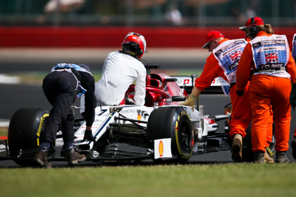 Kimi Raikkonen, Alfa Romeo Racing C38 sits on his car as marshals push after stopping on track