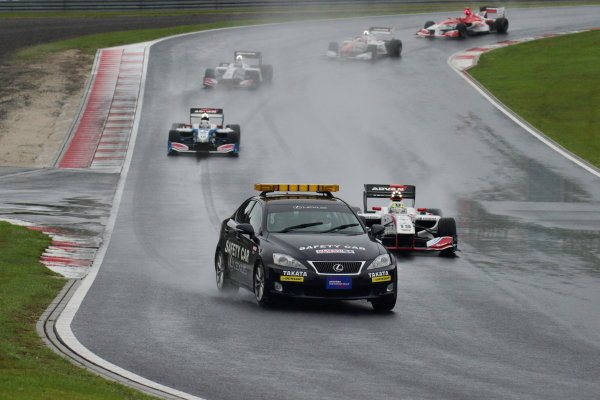 The start of the race with the safety car leading winner Yuhi Sekiguchi, Itochu Enex Team Impul SF14 Toyota, and the rest of the field.