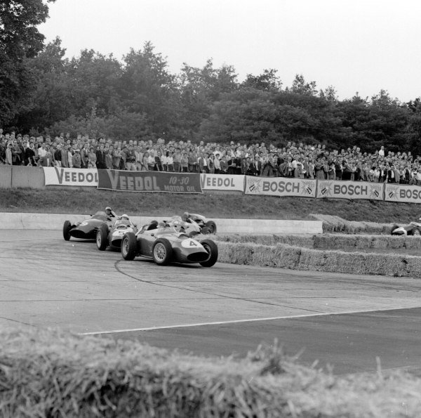 1959 German Grand Prix.Avus, Berlin, Germany.31/7-2/8 1959.Stirling Moss leads Maurice Trintignant (both Cooper T51 Climax) and Carroll Shelby (Aston Martin DBR4/250) into the hairpin.Ref-4653.World Copyright - LAT Photographic