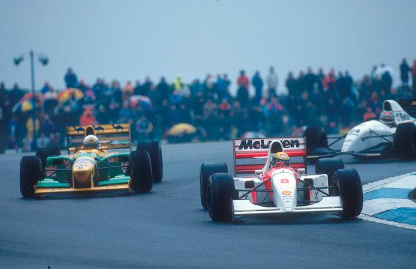 1993 European Grand Prix. Donington Park, England. 9-11 April 1993. Ayrton Senna (McLaren MP4/8 Ford) passes Riccardo Patrese (Benetton B193B Ford) at Goddard Corner with Fabrizio Barbazza (Minardi M193 Ford) behind. Ref-93 EUR 31. World Copyright - LAT Photographic