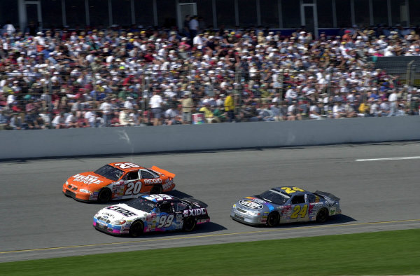 2000 Daytona 500, February 20, 2000, Daytona, FL, USAJeff Burton and Tony Stewart race while Jeff Gordon follows.2000 Daytona NASCAR-2000, Michael L. Levitt, USALAT PHOTOGRAPHIC