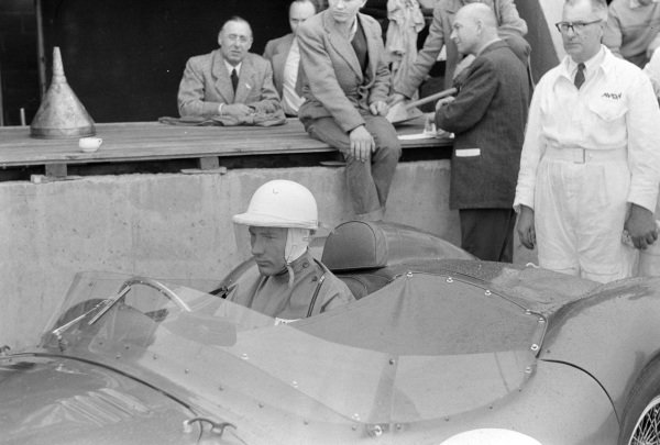Stirling Moss in the Aston Martin DBR1/300 he shared with Jack Brabham.