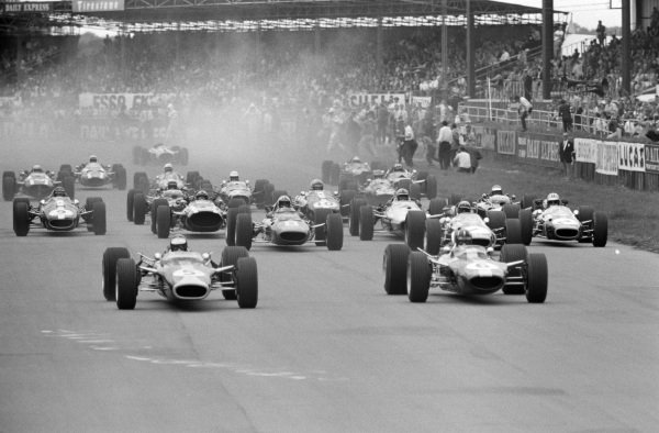Jim Clark, Lotus 49 Ford, leads Graham Hill, Lotus 49 Ford, at the start.