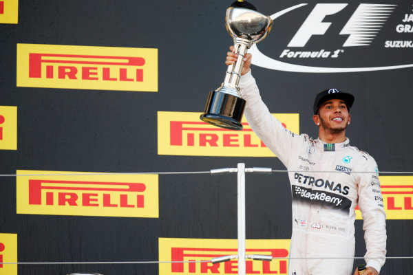 Suzuka Circuit, Suzuka, Japan. Sunday 27 September 2015. Lewis Hamilton, Mercedes AMG, 1st Position, with his trophy on the podium. World Copyright: Alastair Staley/LAT Photographic. ref: Digital Image _R6T2639