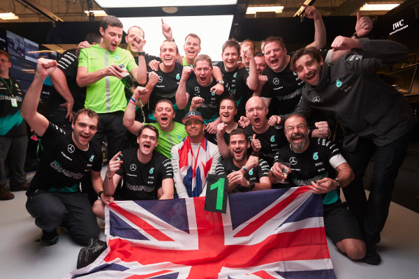 Circuit of the Americas, Austin, Texas, United States of America. Sunday 25 October 2015. Lewis Hamilton, Mercedes AMG celebrates with his team in the garage. World Copyright: Steve Etherington/LAT Photographic. ref: Digital Image SNE16224