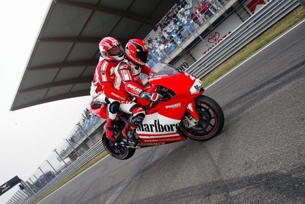 Randy Mamola (USA) Ducati, treats his passenger to a stoppie. Marlboro Demonstrations, Marlboro Masters, Zandvoort, Holland, 9-10 August 2003.DIGITAL IMAGE