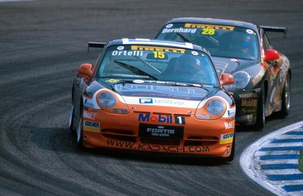Second place finisher Stephane Ortelli (FRA) leads the race winner Timo Bernhard (GER)  Ð the two enjoyed an exciting battle for the lead.