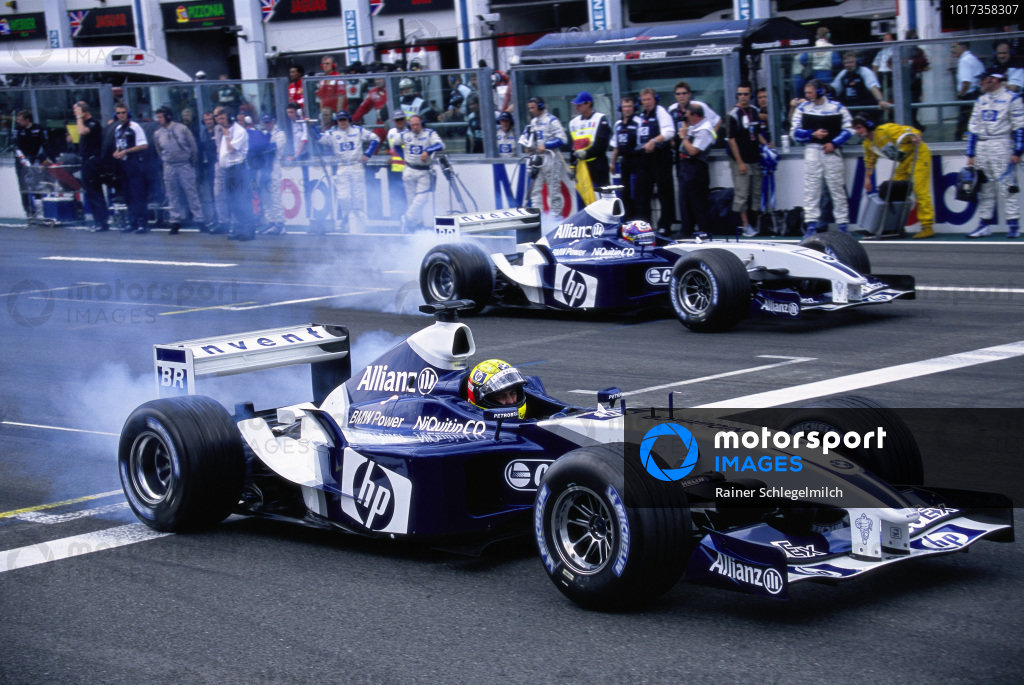 Ralf Schumacher, Williams FW25 BMW, leads Juan Pablo Montoya, Williams FW25 BMW, on the formation lap.