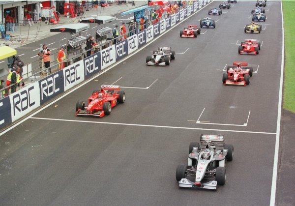 1998 British Grand Prix. Silverstone, England. 10-12 July 1998. Mika Hakkinen (McLaren MP4/13 Mercedes-Benz) leads at the start. World Copyright - LAT Photographic