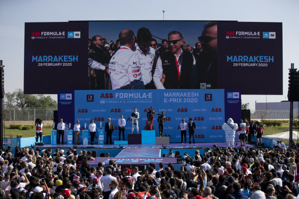 A crowd gathers for the podium ceremony