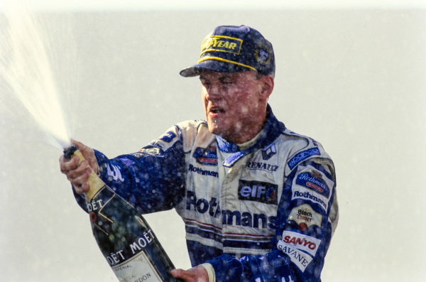 David Coulthard, 1st position, sprays champagne on the podium.