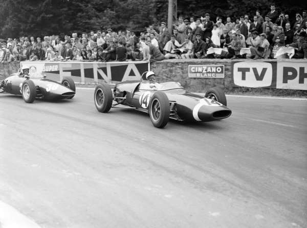 Stirling Moss, Lotus 18/21 Climax, leads Tony Brooks, BRM P48/57 Climax.