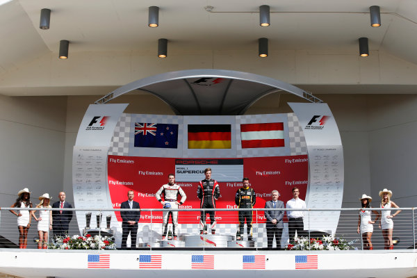2014 Porsche Supercup. Sunday 2 November 2014. Michael Ammermuller, No.4 Lechner Racing Team, 1st Position, Earl Bamber, No.19 Fach Auto Tech, 2nd Position, and Philipp Eng, No.12 Team Project 1, 3rd Position, on the podium.  World Copyright: /LAT Photographic. ref: Digital Image _89P8509