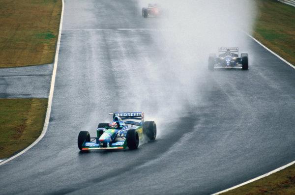 Suzuka, Japan. 4th - 6th November 1994. Michael Schumacher (Benetton B194 Ford) leads Damon Hill (Williams FW16B Renault).World Copyright - LAT Photographic