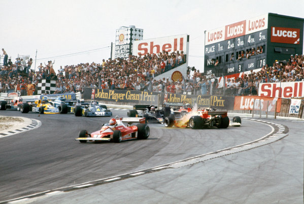 Brands Hatch, England. 16th - 18th July 1976. Clay Regazzoni (Ferrari 312T2), Disqualified, crashes into Niki Lauda (Ferrari 312T2), 1st position, at the top of Paddock Hill Bend with James Hunt (McLaren M23-Ford), Disqualified, causing the race to be stopped, action. World Copyright: LAT Photographic. Ref:  76 GB 07.
