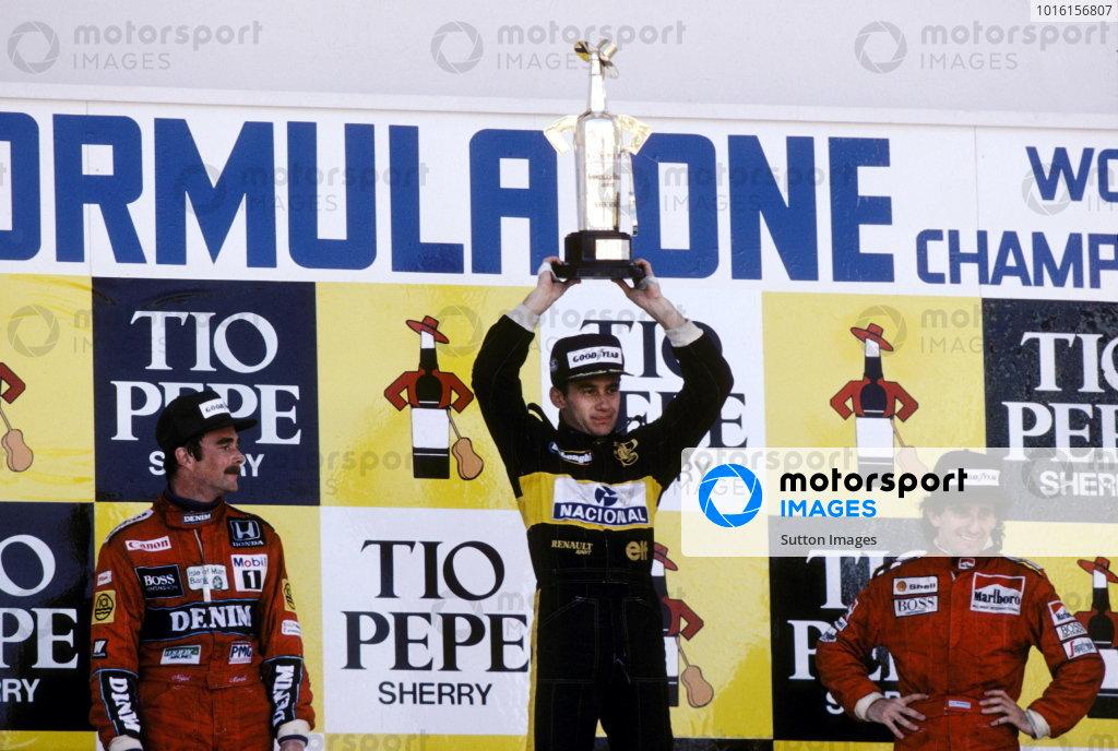 The podium to the closest race finish of all time (L to R): Nigel Mansell (GBR) Williams second; Ayrton Senna (BRA) Lotus winner; Alain Prost (FRA) McLaren third. Spanish Grand Prix, Jerez, 13 April 1986.