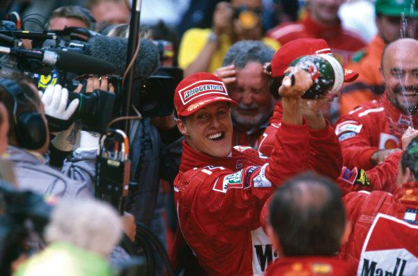 Monte Carlo, Monaco. 13-16 May 1999. Michael Schumacher (Ferrari F399) celebrates his 1st position, portrait.  World Copyright: LAT Photographic. Ref:  99 MON 04.