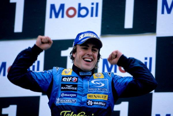 2005 German Grand Prix. Hockenheim, Germany 22nd - 24th July 2005 Fernando Alonso, Renault R25 celebrates his victory on the podium. World Copyright: Lorenzo Bellanca/LAT Photographic Ref: 35mm Image A01
