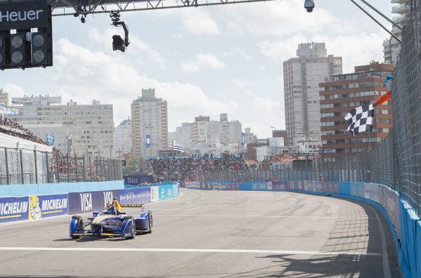2015/2016 FIA Formula E Championship. Punta del Este ePrix, Punta del Este, Uruguay. Saturday 19 December 2015. Sebastien Buemi (SUI), Renault e.Dams Z.E.15 takes the chequered flag to win the race. Photo: Jed Leicester/LAT/Formula E ref: Digital Image _L2_5319