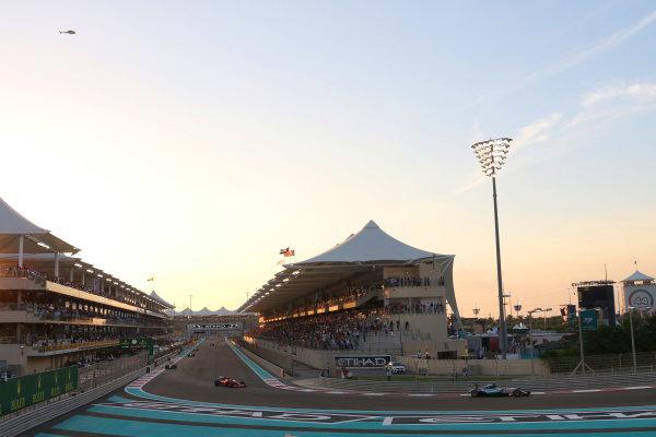 Yas Marina Circuit, Abu Dhabi, United Arab Emirates. Sunday 29 November 2015. Lewis Hamilton, Mercedes F1 W06 Hybrid, leads Kimi Raikkonen, Ferrari SF-15T. World Copyright: Will Taylor-Medhurst/LAT Photographic ref: Digital Image 267A9963