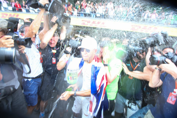 Autodromo Hermanos Rodriguez, Mexico City, Mexico. Sunday 29 October 2017. Lewis Hamilton, Mercedes AMG, sprays Champagne at photographers in celebration of securing his 4th world drivers championship title. World Copyright: Charles Coates/LAT Images  ref: Digital Image DJ5R7719