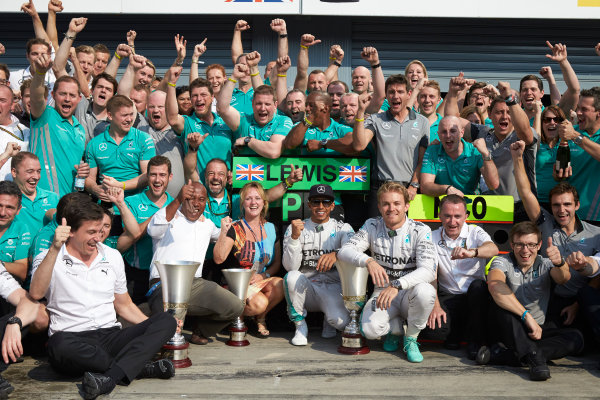 Autodromo Nazionale di Monza, Monza, Italy. Sunday 7 September 2014. Lewis Hamilton, Mercedes AMG, 1st Position, Nico Rosberg, Mercedes AMG, 2nd Position, Toto Wolff, Executive Director (Business), Mercedes AMG. Paddy Lowe, Executive Director (Technical), Mercedes AMG, and the Mercedes AMG team celebrate. World Copyright: Steve Etherington/LAT Photographic. ref: Digital Image SNE15864