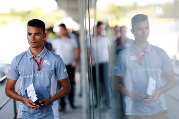 Hungaroring, Budapest, Hungary. Friday 22 July 2016. Pascal Wehrlein, Manor Racing MRT, with an Anti-doping leaflet from the drivers briefing. World Copyright: Andy Hone/LAT Photographic ref: Digital Image _ONY0919