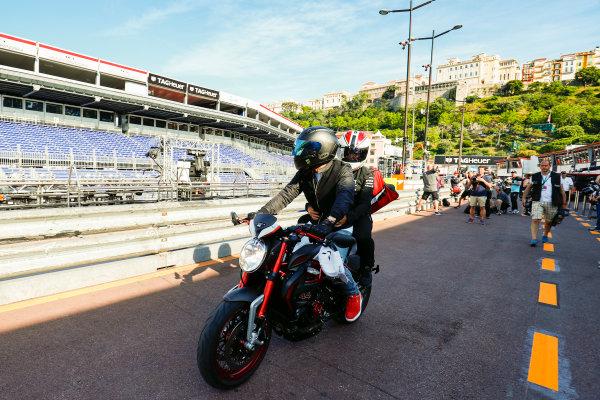 Monte Carlo, Monaco. Wednesday 24 May 2017. Lewis Hamilton, Mercedes AMG, leaves the pits on his motorcycle. World Copyright: Sam Bloxham/LAT Images ref: Digital Image _W6I0534