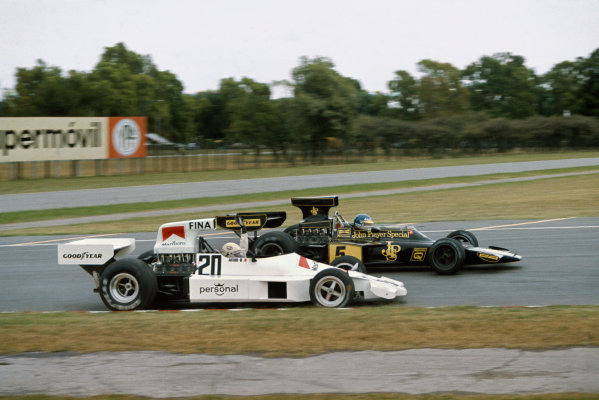 Buenos Aires, Argentina.  10-12 January 1975.  Arturo Merzario, Williams FW Ford, is passed by Ronnie Peterson, Lotus 72E Ford.  Ref: 75ARG13. World Copyright - LAT Photographic