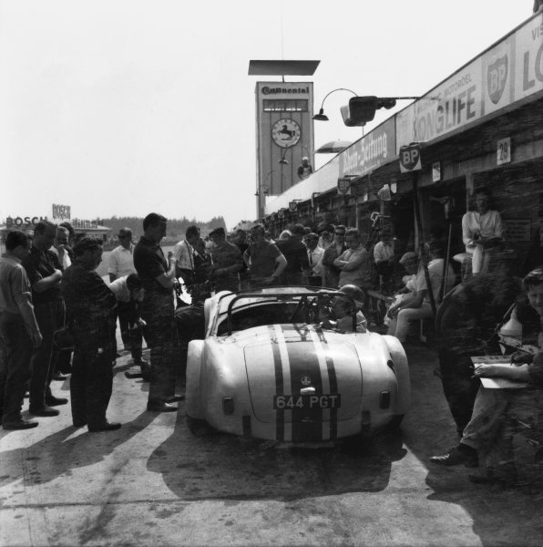 Nurburgring, Germany. 31st May 1964. Rd 7.Bob Olthoff/Paul Hawkins (Shelby-Ford Cobra), 47th position, pit stop action. World Copyright: LAT Photographic.Ref:  64Ring 01.