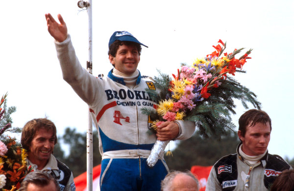 1979 Belgian Grand Prix.Zolder, Belgium.11-13 May 1979.Jody Scheckter (Ferrari) 1st position, Jacques Laffite (Ligier Ford) 2nd position and Didier Pironi (Tyrrell Ford) 3rd position on the podium.Ref-79 BEL 02.World Copyright - LAT Photographic