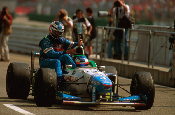 Hockenheim, German.26-28 July 1996.Gerhard Berger gets a lift back to the pits with teammate Jean Alesi (Benetton B196 Renault) after being 3 laps from victory.Ref-96 GER 11.World Copyright - LAT Photographic