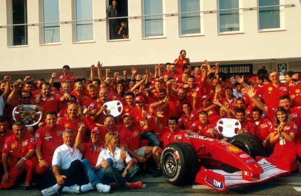 A Ferrari team portrait after a perfect weekend: a 1-2 finish, a World Drivers Championship for Michael Schumacher (GER), and the Constructors Championship secured with four rounds to spare. 