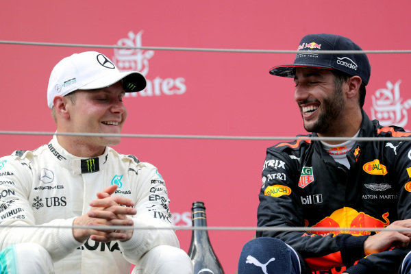 Race winner Valtteri Bottas (FIN) Mercedes AMG F1 celebrates on the podium with Daniel Ricciardo (AUS) Red Bull Racing at Formula One World Championship, Rd9, Austrian Grand Prix, Race, Spielberg, Austria, Sunday 9 July 2017.
