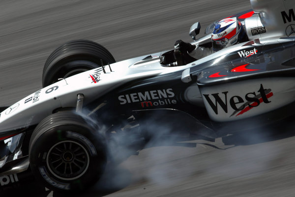 2003 Malaysian Grand Prix.  Sepang, Kuala Lumpur, Malaysia. 21-23 March 2003. Kimi Raikkonen (McLaren MP4/17D Mercedes) 1st position and his maiden Grand Prix win. World Copyright - Steve Etherington/LAT Photographic  ref: Digital Image Only