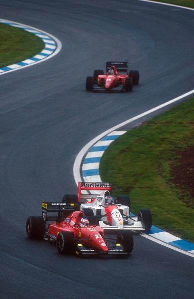 1992 Spanish Grand Prix.Catalunya, Barcelona, Spain.1-3 May 1992.Jean Alesi (Ferrari F92A) passes Gerhard Berger (McLaren MP4/7A) with Ivan Capelli (Ferrari F92A) behind.Ref-92 ESP 08.World Copyright - LAT Photographic