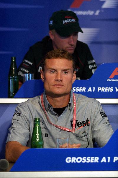 2001 Austrian Grand Prix.A1-Ring, Zeltweg, Austria.11-13 May 2001.David Coulthard (McLaren Mercedes) and Eddie Irvine (Jaguar) at a press conference.World Copyright - Rose/LAT Photographicref: 8 9 MB Digital